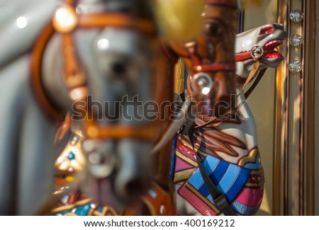 Bright carousel in a holiday park. Horses on a traditional fairground vintage  carousel. (Real Photo)