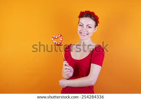 bright cheerful girl with a heart - stock photo