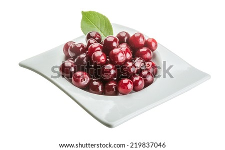 Bright Cherry in the bowl with leaf