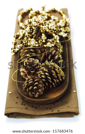 Bright christmas composition with Golden pine cones - stock photo