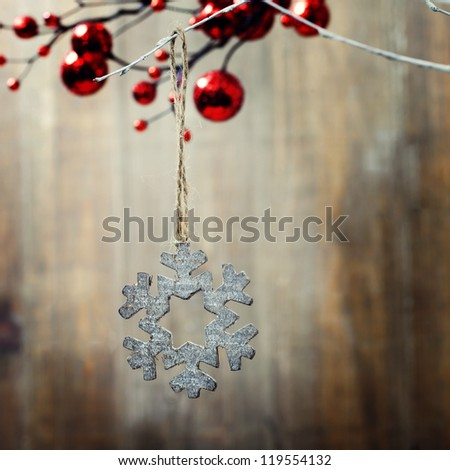 Bright christmas composition with wooden snowflake - stock photo