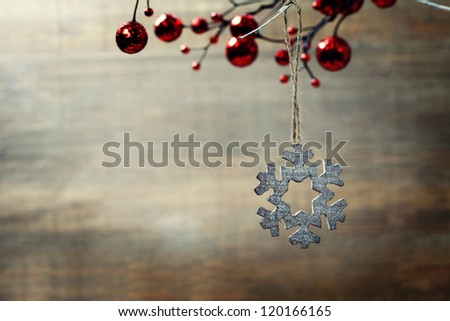 Bright christmas composition with wooden snowflake