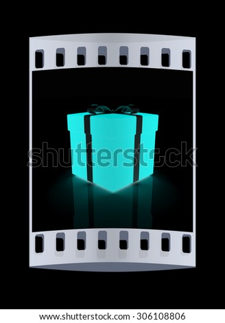 Bright christmas gift on a black background. The film strip - stock photo