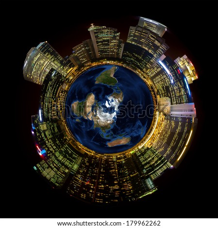 Bright city lights on miniature planet illustrates concept of growing energy usage on our earth's shrinking resources. Earth Day and Earth Hour concepts. - stock photo