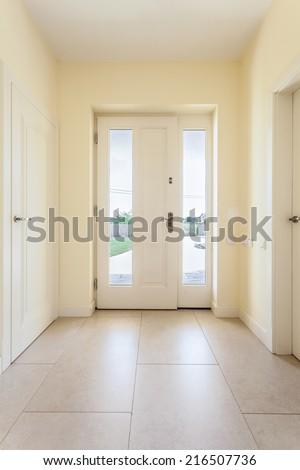 Bright clean corridor with window door in modern house - stock photo