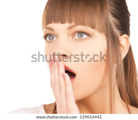 bright closeup picture of woman with hand over mouth. - stock photo