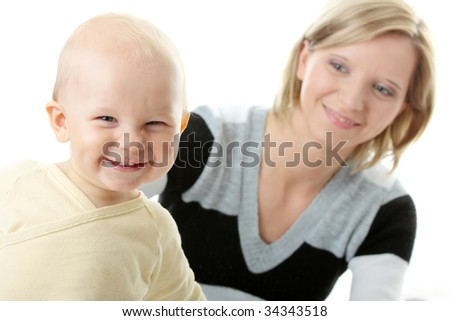 Bright closeup portrait of adorable baby boy and his mom - stock photo