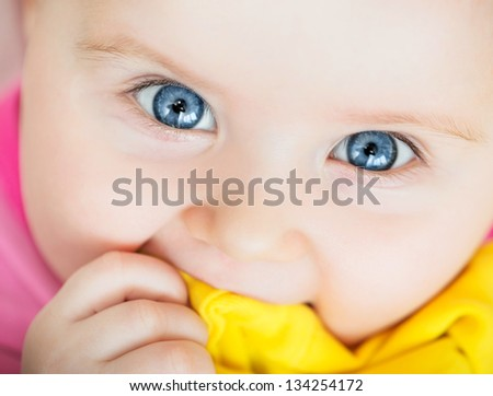 bright closeup portrait of funny adorable baby - stock photo