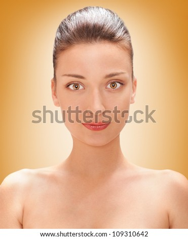 bright closeup portrait picture of beautiful , brown colored eyes woman with yellow background - stock photo