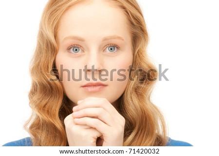 bright closeup portrait picture of praying businesswoman - stock photo
