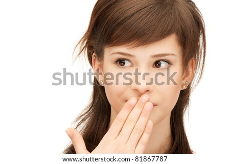 bright closeup portrait picture of teenage girl with palms over mouth