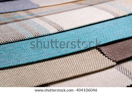 Bright collection of colorful gunny textile samples. Fabric texture background - stock photo