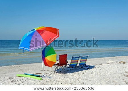 Bright Color Beach Umbrellas and Chairs on the Beach - stock photo