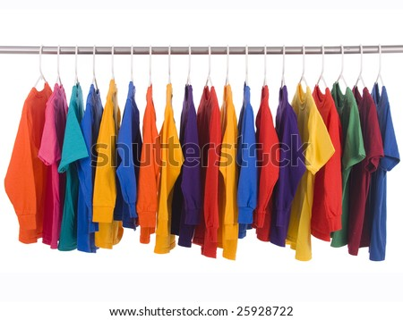 bright colored Tee Shirts hanging on a clothesline.