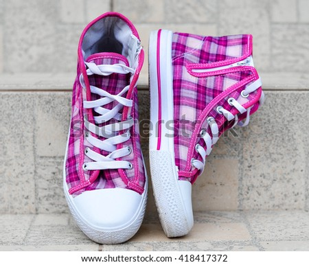 Bright colored trendy sneakers - stock photo