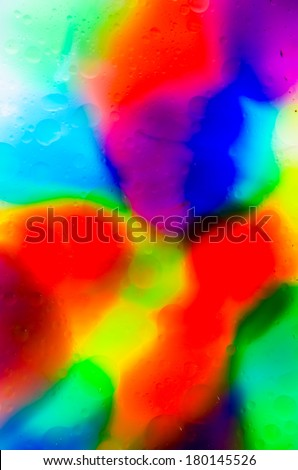 Bright colorful food coloring in water & oil for abstract background - stock photo