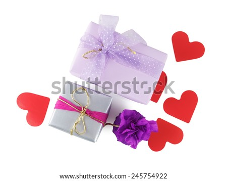 Bright colorful gift boxes with paper hearts on a white background. Isolated with clipping path. Top view. - stock photo
