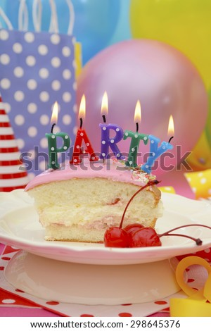 Bright colorful Happy Party Table with balloons, streamers, party favor gift bags with slice of cake and lit candles spelling party.  - stock photo