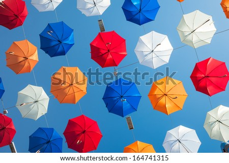 bright colorful umbrelas on blue sky background