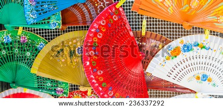 Bright colors on these traditional Spanish Fans in Saville, Andalusia Region. - stock photo