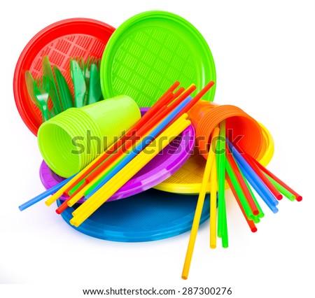 Bright colourful plastic kitchenware isolated on white - stock photo
