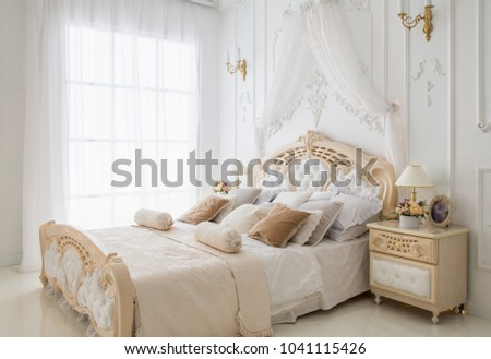 Bright comfortable bedroom with big window