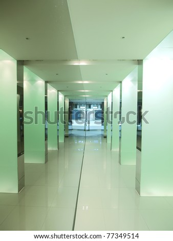 Bright corridor in modern building - stock photo