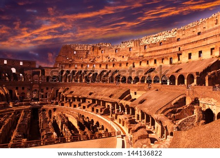 Bright crimson sunset over the ancient Colosseum. Rome. Italy - stock photo