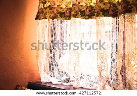 Bright curtains with a light and a window - stock photo