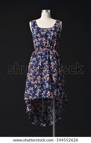Bright elegant dress on a mannequin on a black background
