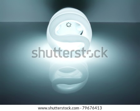bright energy saving fluorescent light bulb - stock photo