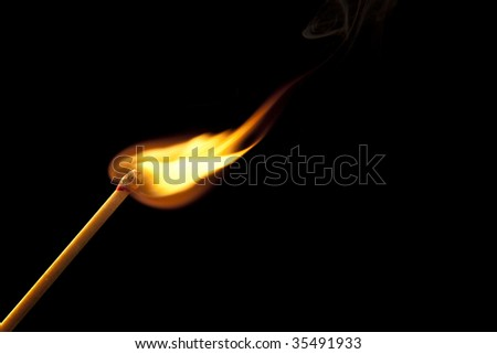 Bright flame on match stick - stock photo