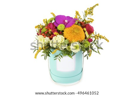 Bright floral bouquet arrangement in a box on a white background, isolated