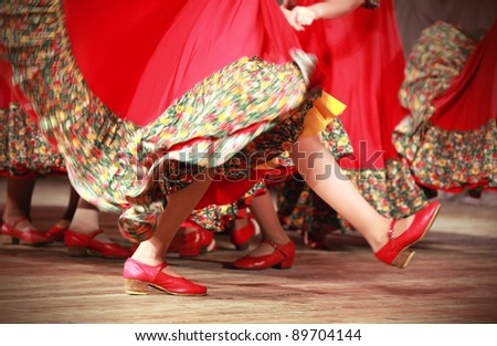Bright fragment of fast Russian folk dance with red girls waved skirt - stock photo