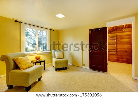 Bright furnished room with carpet floor. Walki-in closet - stock photo