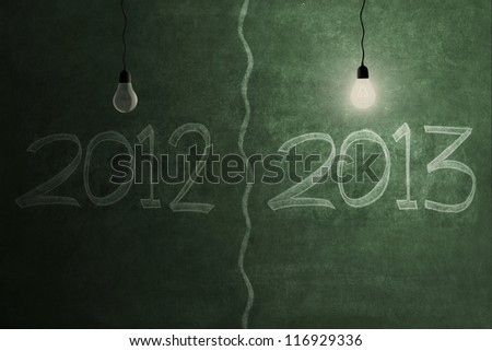 Bright future concept with bright light bulb on 2013 and light bulb is off on 2012 - stock photo