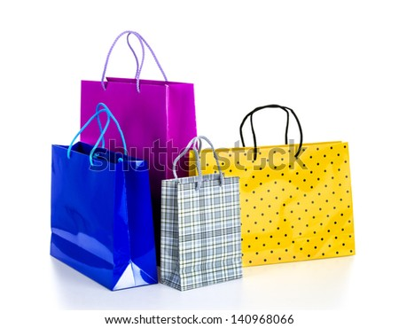 Bright gift bags isolated on white background - stock photo