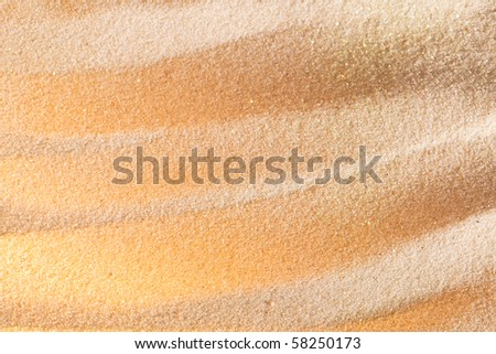 bright glitter sand, shallow DOF, different kind of color lights - stock photo