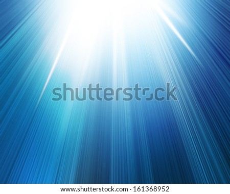 bright glowing summer sun on a soft blue background