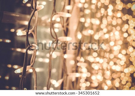 bright gorgeous beautiful christmas lights on the window in the street on a christmas day - stock photo