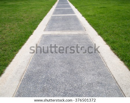 Bright green grass field and walkway for background wallpaper