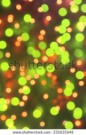 Bright green Lights on dark red background. abstract silver background with texture,  holiday bokeh. Abstract Christmas background - stock photo