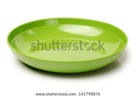 Bright green plastic empty bowl on a white background - stock photo