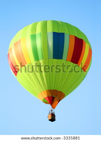 Bright Green Striped Hot Air Balloon - stock photo