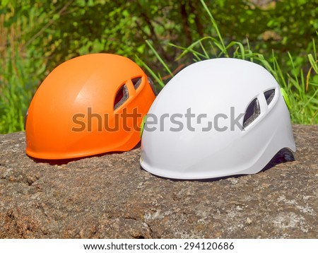 Bright helmets for safety lie on the stone.