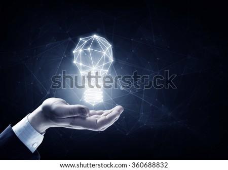 Bright idea in hand - stock photo