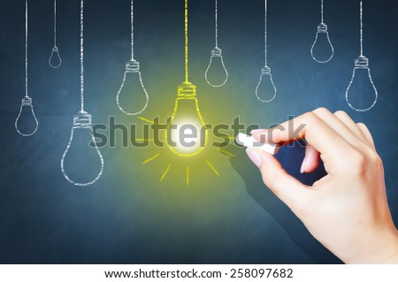 Bright idea on blackboard concept - stock photo