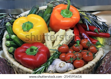 Bright juicy vegetables stacked in a wicker basket - stock photo