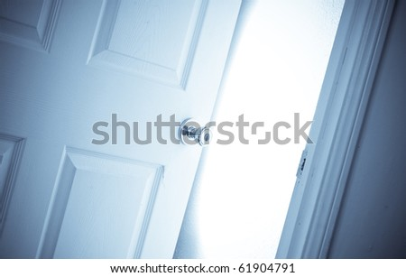 Bright Light Coming From Inside Open Door - stock photo
