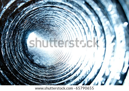 Bright light within Air Conditioning Duct. A shot from within an Air Conditioning Ducting pipe. Intentionally overexposed white light shines in from one end creating an interesting effect. - stock photo